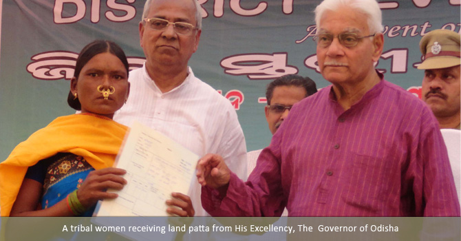 A tribal women receiving land patta from His Excellency, The  Governor of Odisha
